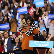 Winston-Salem, NC - October, 27 2016:  Hillary Clinton and Michelle Obama embrace before the both address the crowd at a campaign stop at Lawrence Joel Veterans Memorial Coliseum. CREDIT: LOGAN R CYRUS
