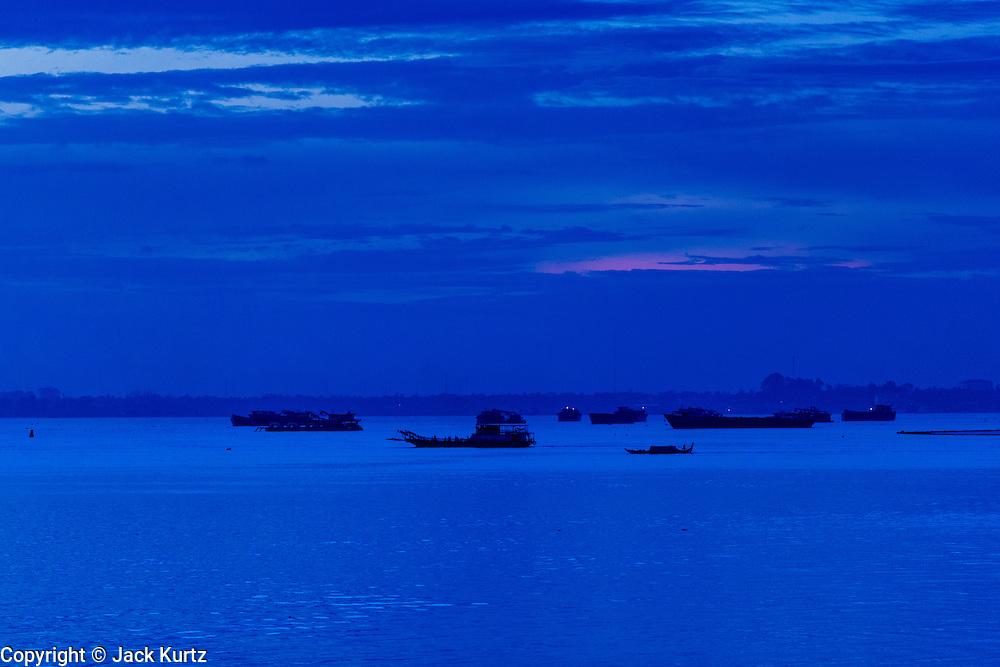 29 JUNE 2013 - PHNOM PENH, CAMBODIA: Boats on the Mekong River in Phnom Penh, Cambodia.      PHOTO BY JACK KURTZ