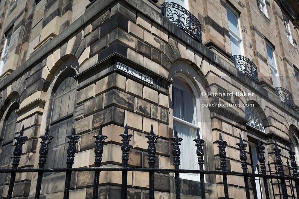Railing ironwork and housing architecture on Moray Place, in Edinburgh, on 26th June 2019, in Edinburgh, Scotland.