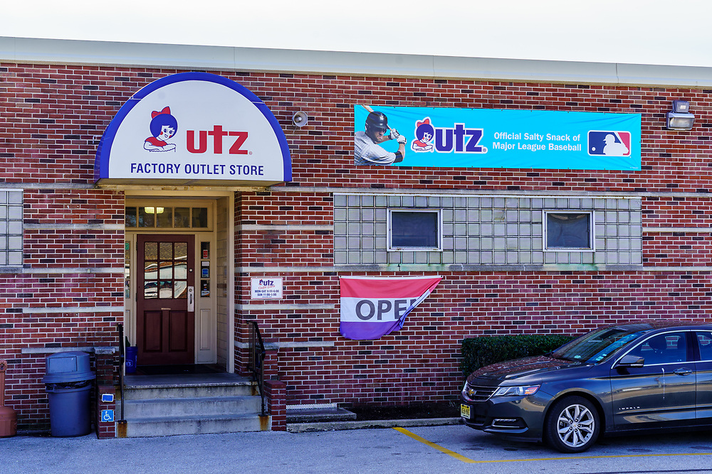 Hanover, PA / USA - February 19, 2020: Utz Potato Chip Company sign on the factory and outlet building in Hanover.