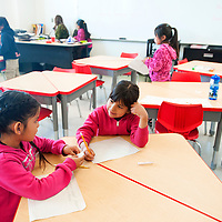 042513       Brian Leddy<br /> McKayla Chiquito and Jasmine Charles complete an assignment in their first-grade class at Crownpoint Elementary Thursday afternoon. The new school features several innovations, including quiet and comfortable classrooms and new desks that allow more variation in how a classroom is set up.