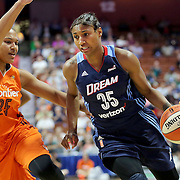 UNCASVILLE, CONNECTICUT- JUNE 3:  Angel McCoughtry #35 of the Atlanta Dream drives past Alyssa Thomas #25 of the Connecticut Sun during the Atlanta Dream Vs Connecticut Sun, WNBA regular season game at Mohegan Sun Arena on June 3, 2016 in Uncasville, Connecticut. (Photo by Tim Clayton/Corbis via Getty Images)