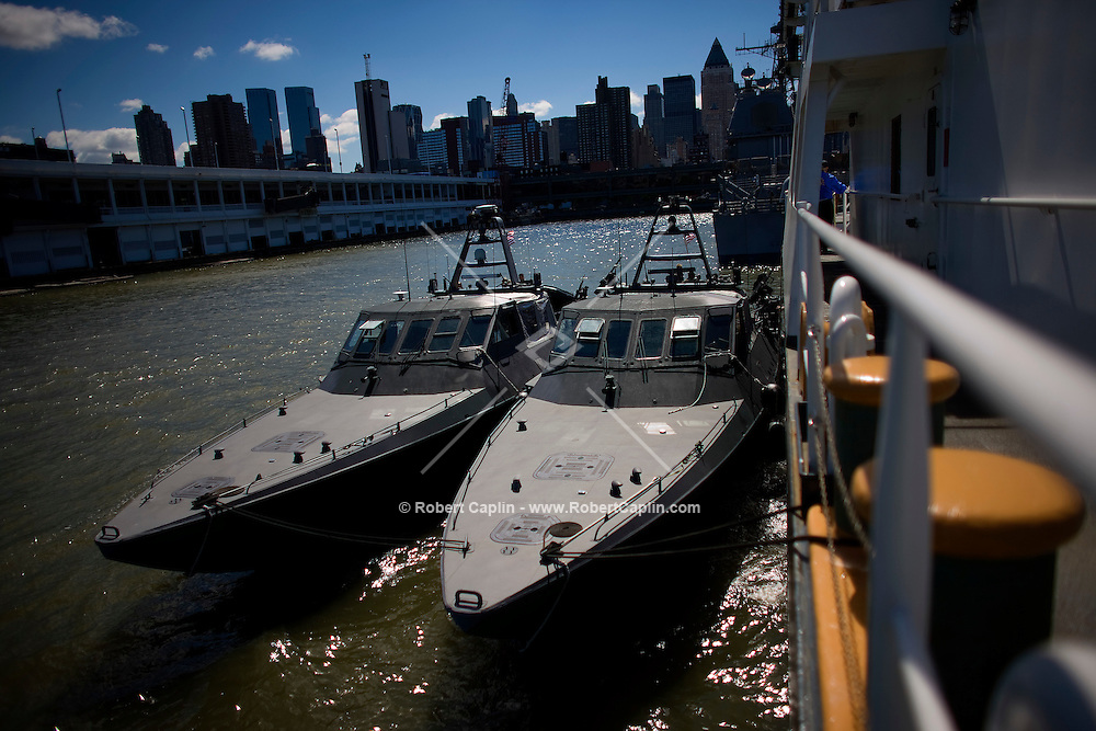 Two NAVY SEAL Mark V extraction boats are docked onto a US Coast Guard vessel on Pier 88 in Manhattan during Fleet Week 2008.  May 23, 2008.