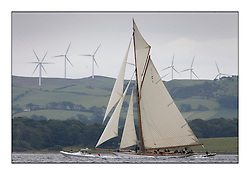 Mariquita 1911 a 19 metre with windfarms in the background...The Round the Cumbraes race to open the regatta. Light variable breeze and grey skies shrouded the fleet with a strong spectator fleet...* The Fife Yachts are one of the world's most prestigious group of Classic .yachts and this will be the third private regatta following the success of the 98, .and 03 events.  .A pilgrimage to their birthplace of these historic yachts, the 'Stradivarius' of .sail, from Scotland's pre-eminent yacht designer and builder, William Fife III, .on the Clyde 20th -27th June.   . ..More information is available on the website: www.fiferegatta.com . .Press office contact: 01475 689100         Lynda Melvin or Paul Jeffes