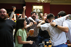 © Licensed to London News Pictures. 29/06/2021. London, UK. Fans react at The Salisbury Hotel in north London, after England's Raheem Sterling scores a goal, in their Euro 2020 football match against Germany. Photo credit: Dinendra Haria/LNP