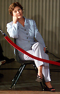 First Lady Laura Bush listens to U.S. President George W. Bush at a news conference in Crawford, Texas August 24, 2001.  Bush announced his pick for Chairman of the Joint Chiefs of Staff, Gen. Richard Myers. REUTERS/Rick Wilking