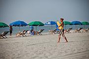 Lifeguards set up Beach umbrellas on the beach in Myrtle Beach, SC.