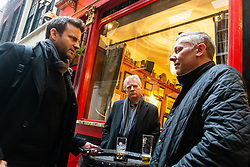 Financial PR Director Andy Fleming, centre, and Lobbyist Dan Guthrie, right, talk with Bild journalist Philip Fabian about Brexit at the Ship and Shovell pub in Charing Cross, in London. London, January 16 2019.