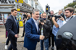 © Licensed to London News Pictures. 26/09/2021. EMBARGOED UNTIL 27 SEPTEMBER 2021 .Brighton, UK. Labour Party Leader SIR KEIR STARMER leaves in his car after visiting shops and cafes on George Street in Hove . The second day of the 2021 Labour Party Conference , which is taking place at the Brighton Centre . Photo credit: Joel Goodman/LNP