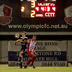 BRISBANE, AUSTRALIA - APRIL 7: Linden Farr of Olympic FC and Mitchell Here of Brisbane City compete for the ball during the NPL Queensland Senior Men's Round 7 match between Olympic FC and Brisbane City at Goodwin Park on April 7, 2017 in Brisbane, Australia. (Photo by Patrick Kearney/Olympic FC)