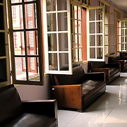 Colonial-style corridor with windows and seats. The Museum of the Vietnamese Revolution in the Tong Dan area of Hanoi, not far from Hoan Kiem Lake, was established in 1959 and is devoted to the history of the socialist revolutionary movement in Vietnam.