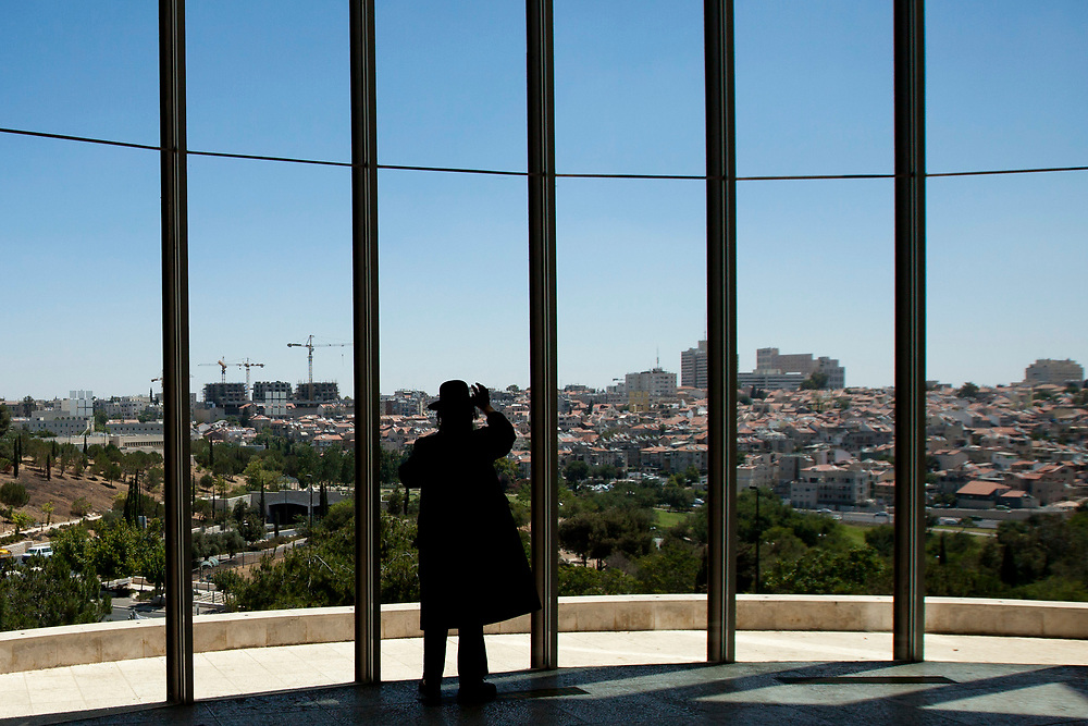 With Jerusalem's city center in the background, an Ultra-Orthodox man is seen at the halls of the Supreme Court, on June 15, 2010, prior to a discussion regarding the segregation between Ashkenazi and Sephardic Jewish girls at the Beit Yaakov school in Immanuel.