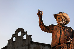 """Bronze statue of Red Steagall, Fort Worth Stockyards National Historic District, Fort Worth, Texas, USA. Sculpture is titled """"Always Riding for the Brand"""" by Bruce Greene CA, and was dedicated in 2019."""