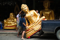 Bamrung Muang Road near Bangkok City Hall and Wat Suthat is the largest center for Buddhist supply shops in the country. Originally an elephant trail, this was one of the first paved roads in Bangkok. Here you can pick up a giant Buddha, delivery negotiable. A variety of shops sell Buddhist paraphernalia: giant orange candles, monks robes, and statues of all sizes.
