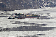 Bear Mountain, New York - A tugboat pushes barge south on the Hudson River just south of the Bear Mountain Bridge on Feb. 20, 2007.