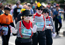 A trio of mimes make their way through Golden Gate Park at the 107th running of the Bay to Breakers, Sunday, May 20, 2018, in San Francisco. (Photo by D. Ross Cameron)