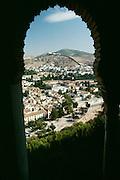 Spain, Granada, Islamic window at The Alhambra.