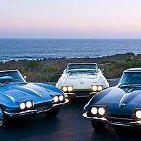 Corvettes on beach at sunset