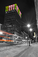 Downtown Huntington, West Virginia looking down third avenue at The West Virginia Building and Kieth Albee Theatre lit up at night after a snowfall.