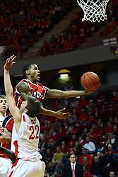 04 February 2012:  Walt Lemon Jr. scoops a shot while leaning over Jon Ekey during an NCAA Missouri Valley Conference mens basketball game where the Bradley Braves lost to the Illinois State Redbirds 78 - 48 in Redbird Arena, Normal IL