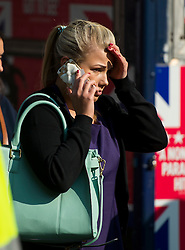 © Licensed to London News Pictures. 09/07/2015. London, UK. A distressed commuter at Victoria station, queuing for a bus. Commuters stranded at Victoria Station in London on the day of a network wide tube strike which finishes at 9.30 this evening. Photo credit: Ben Cawthra/LNP