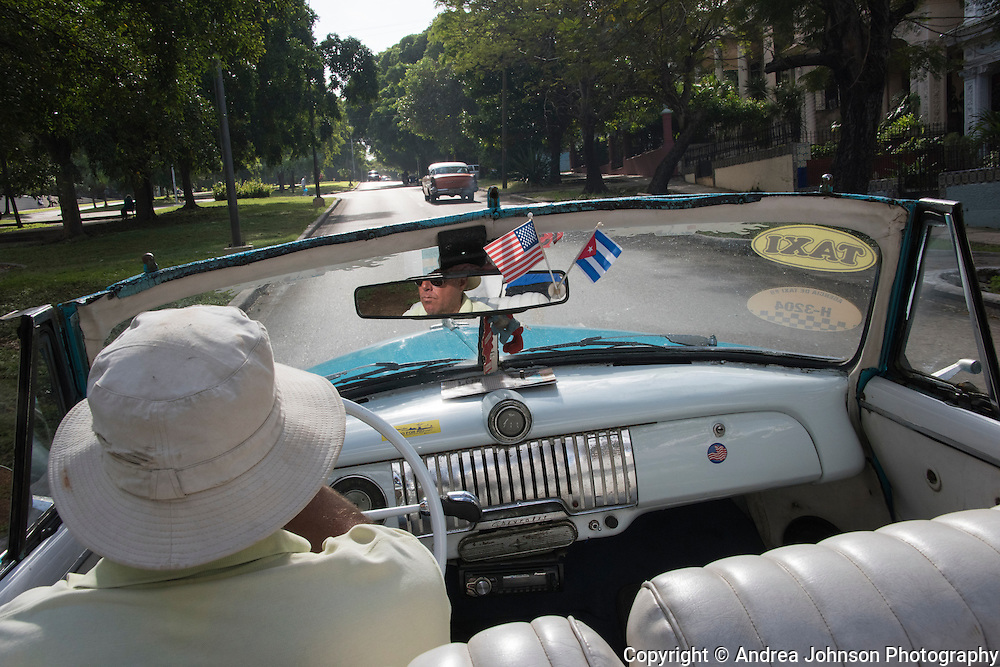 Crusing in a classic convertible through Havana's neighborshoods, Cuba