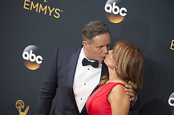 September 18, 2016 - Los Angeles, California, U.S. - MARK BURNETT kisses wife ROMA DOWNEY as they arrive for the 68th Annual Primetime Emmy Awards, held at the Nokia Theatre. (Credit Image: © Kevin Sullivan via ZUMA Wire)