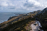 Trail walks in Holyhead Breakwater Country Park on the coast of Holyhead, on 20th February 2020 in Anglesey, North Wales, United Kingdom. The country park opened in 1990 and is on the site of an old stone quarry.