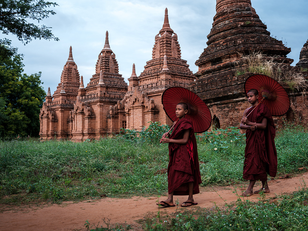 BAGAN, MYANMAR - CIRCA DECEMBER 2017: Monks walking outside an old pagoda in Bagan