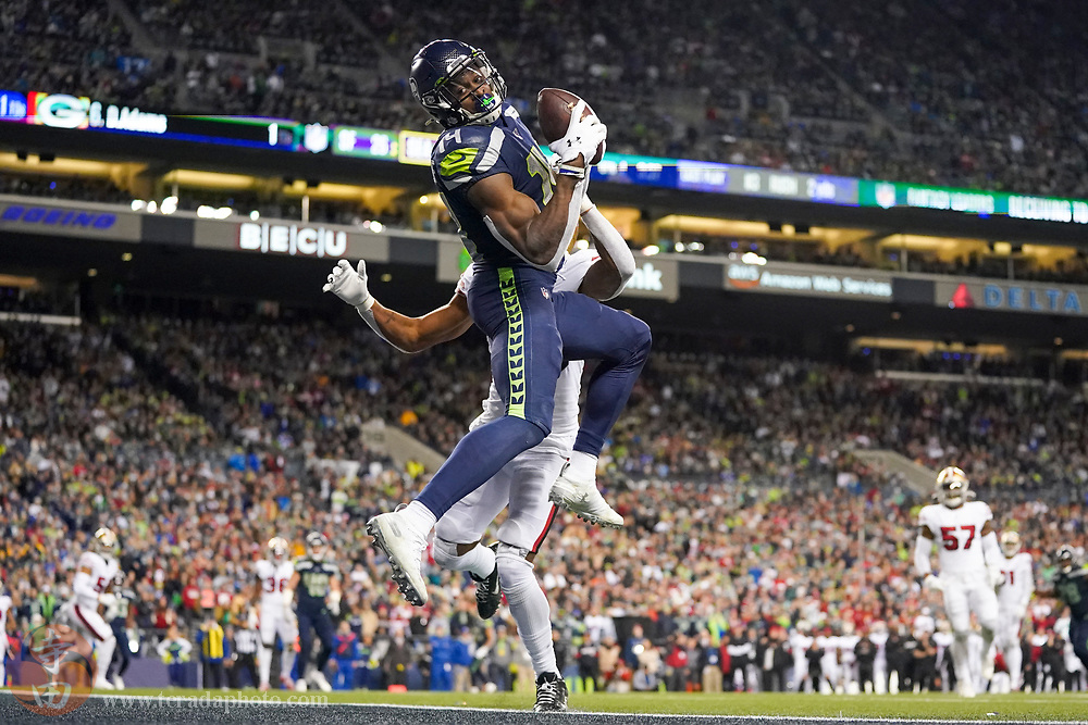 December 29, 2019; Seattle, Washington, USA; Seattle Seahawks wide receiver D.K. Metcalf (14) catches a touchdown against San Francisco 49ers cornerback Ahkello Witherspoon (23) during the fourth quarter at CenturyLink Field.