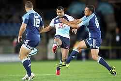 Kurtley Beale kicks ahead. Investec Super Rugby - Blues v Waratahs, Eden Park, Auckland, New Zealand. Saturday 16 April 2011. Photo: Clay Cross / photosport.co.nz