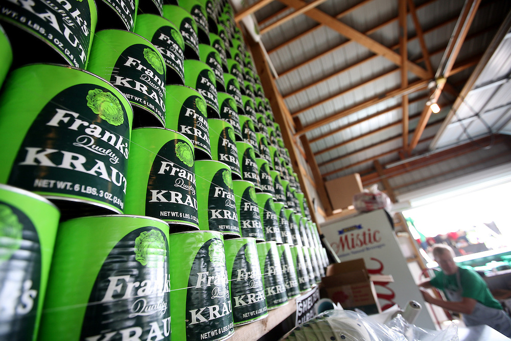 Cans of Frank's Kraut are stacked tall at Sauerkraut Days in Henderson, MN, June 23, 2012.
