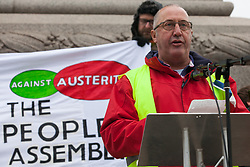 London, UK. 12th January, 2019. Erick Simon, 57, of the French 'gilets jaunes' addresses hundreds of protesters taking part in a 'Britain is Broken: General Election Now' demonstration organised by the People's Assembly Against Austerity. Organisers argued that the overriding objective of working people in the UK should be to remove the Conservative Government from power through a general election regardless of their vote in the EU referendum.