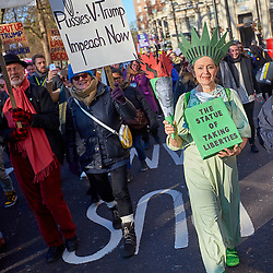 © Licensed to London News Pictures. 21/01/2017. LONDON, UK.  Over 50,000 people take part in the Womens Equality March through London. Held the day after the inauguration of President Trump the protest started outside the US embassy and finished with a rally in Trafalgar Square.  Photo credit: Cliff Hide/LNP