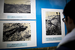 August 9, 2016 - Nagasaki, Nagasaki Prefecture, Japan - NAGASAKI, JAPAN - AUGUST 9 : Students look at old photos of atomic bomb victims exhibited at Nagasaki Peace Park in Nagasaki during the 71st anniversary of the atomic bombing on Nagasaki, southern Japan, Tuesday, August 9, 2016. Japan marked the 71st anniversary of the atomic bombing on Nagasaki. On August 9, 1945, during World War II, the United States dropped the second Atomic bomb on Nagasaki city, killing an estimated 40,000 people which ended World War II. (Credit Image: © Richard Atrero De Guzman/NurPhoto via ZUMA Press)