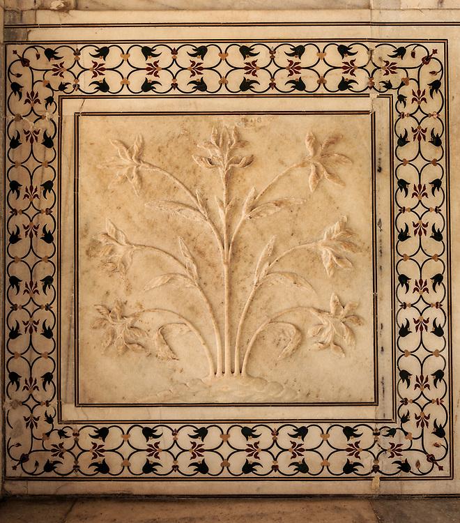 Flowers carved in marble in Taj Mahal in Agra, India.