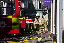 London, UK. 6 June, 2019. London Fire Brigade attends to a fire at Gymkhana, a Michelin-starred Indian restaurant in Mayfair, with at least eight fire engines and 60 firefighters. London Fire Brigade reported that half of the ground floor kitchen and half of the ducting from ground floor to roof level is alight. Fire crews attended from Soho, Lambeth, Kensington, Euston, Paddington, Chelsea and Dowgate.