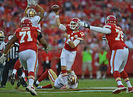 KANSAS CITY, MO - AUGUST 16:  Quarterback Alex Smith #11 of the Kansas City Chiefs attempts to get off a pass against pressure from defensive back Perrish Cox #20 of the San Francisco 49ers during the first half on August 16, 2013 at Arrowhead Stadium in Kansas City, Missouri.  (Photo by Peter Aiken/Getty Images) *** Local Caption *** Alex Smith;Perrish Cox