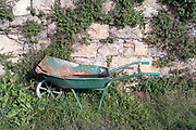 broken abandoned wheelbarrow