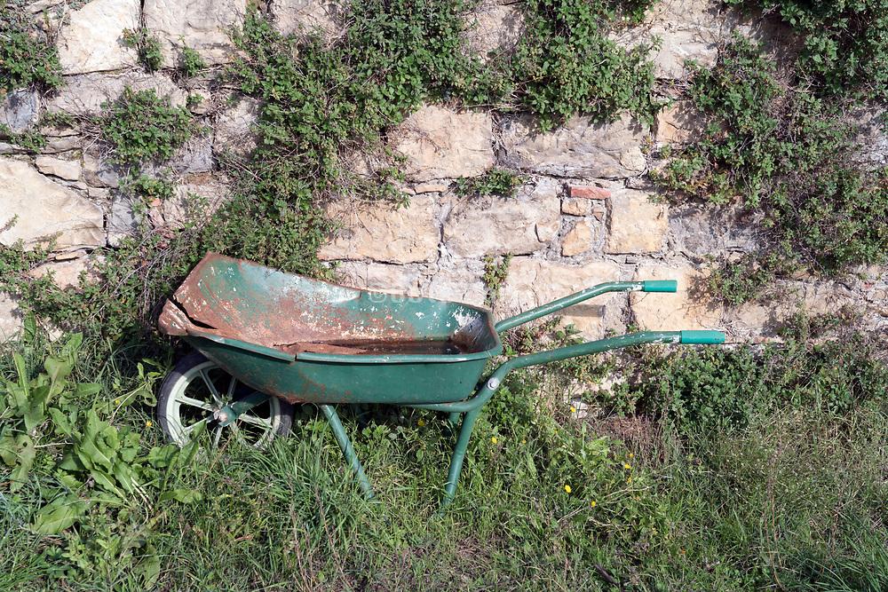 broken abandoned wheelbarrow