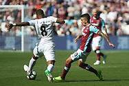 Manuel Lanzini of West Ham United (R) is tackled  by Leroy Fer of Swansea City (L). Premier league match, West Ham Utd v Swansea city at the London Stadium, Queen Elizabeth Olympic Park in London on Saturday 8th April 2017.<br /> pic by Steffan Bowen, Andrew Orchard sports photography.