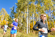 Runners pass a grove of aspen trees along the Government Trail on Buttermilk in the 2011 Golden Leaf half marathon.