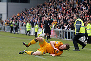 Newport County's Mark O'Brien falls over in the excitement as he celebrates after scoring his sides vital match winning goal. EFL Skybet football league two match, Newport county v Notts County at Rodney Parade in Newport, South Wales on Saturday 6th May 2017.<br /> pic by David Richards, Andrew Orchard sports photography.