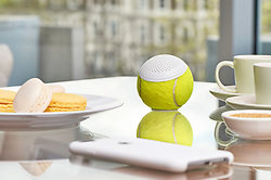 """July 31, 2017 - inconnu - Music fans have been served up a new way to enjoy music –with recycled Wimbledon tennis balls.A company has saved old balls from landfill sites to turn them into Bluetooth speakers by cutting out a specially shaped hole to fit the circuitry,Called HearO, the first edition uses old Slazenger balls from the 2016 grass court championships in London , are converted at a factory in the UK.It can be paired with smartphones, MP3 players, tablets and host of other Bluetooth enabled equipment.The company said hundreds of thousands championship tennis balls are thrown away every year.The firm wanted to make use of these leftover tennis balls as living sports memorabilia, making them useful once again. Thanks to a tennis ball's toughness, size, and multi-layered construction with hollow interior, it is described as a perfect protective case.London-based HearO worked in collaboration with expert rubber cutters from Woodash Group in Northampton, England.The design team said it experimented with different press cuttings and 3D-printed guides to find the best cut shapes and techniques. The speaker grill has been designed to allow for optimal sound projection.A spokesman said: """"The one-button connectivity and intrinsic handheld nature make for the perfect portable media player companion.""""Each 3-watt HearO speaker costs £60 and comes with a charging cradle and is packaged in stylish tin just like tournament tennis balls.The spokesman added:"""" A new category of sports memorabilia. HearO fuses a piece of tennis history with a high-quality wireless speaker. """"The championship ball lives on and becomes an icon of reuse. """"The first edition speaker is made with balls from Wimbledon 2016."""" # DES BALLES DE TENNIS RECYLCEES EN ENCEINTES BLUETOOTH (Credit Image: © Visual via ZUMA Press)"""
