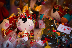 © Licensed to London News Pictures . 22/02/2015 .  Manchester , UK . Souvenirs for sale in Manchester's China Town . Crowds stand out in the snow to watch Chinese New Year celebrations in Manchester today ( Sunday 22nd February 2015) . Photo credit : Joel Goodman/LNP