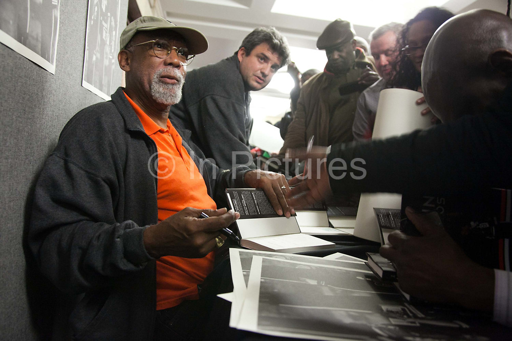 Resistance: The best Olympic Spirit. With John Carlos, Doreen Lawrence, Janet Alder and others. John Carlos signs books to a very happy crowd of fellow political activists. John Carlos won Bronze in the 200 Olympics final in 1968 in Mexico. He and his fellow black American runner, Tommie Smith who won Gold, raised their black gloved fists, wearing no shoes, on the podium to highlight the plight of black Americans. Both lost their medals and were expelled from the American Olympic team and sent home where they faced years of death threats and struggling to keep their careers going. The image of the two men became an iconic symbol of standing up against oppression not just for black Americans but worldwide.