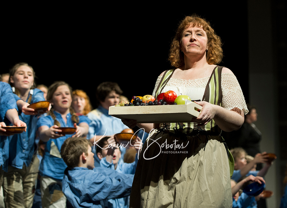 """The workhouse children plead for food only to be ignored by towns person (Jessica Alward) during Thursday evening's dress rehearsal of """"Oliver"""" with the Streetcar Company.  (Karen Bobotas/for the Laconia Daily Sun)"""