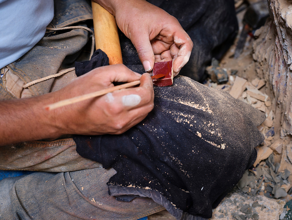 RABAT, MOROCCO - CIRCA APRIL 2017: Detail of hands of a mosaic worker at the Kasbah Oudayas in Rabat