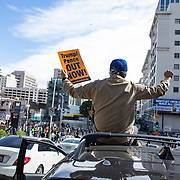 Steven Soto, 28, climbed onto the roof of his car in traffic to join the celebration formed in Los Angeles after the announcement on November 7, 2020 that Joe Biden would be the 46th President of the United States.