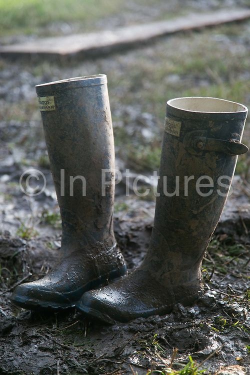 Muddy wellies at the Glastonbury Festival 20th July 2016, Somerset, United Kingdom.  The 2016 festival turned out to be the muddiest festival in years. The Glastonbury Festival runs over 3 days and has 3000 acts, including music, art and performance and approx. 150.000 attend the anual event.